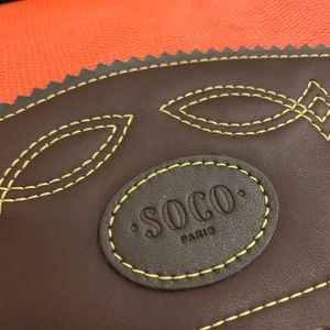 Orange and brown genuine leather saddle bag
